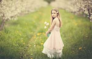 Girl in the orchard during bloom